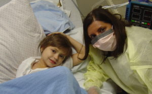 Hayden in Her Room with Her Doctor, Aziza Shad, M.D.