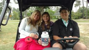 Hayden in family riding in golf kart